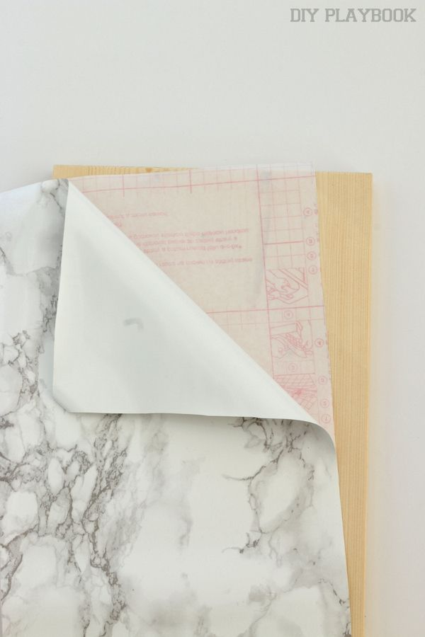 Step by step guide to re-create a DIY Marble Shelf on a budget. Just pick up the supplies from Ikea and you can create this marble and gold look for less!