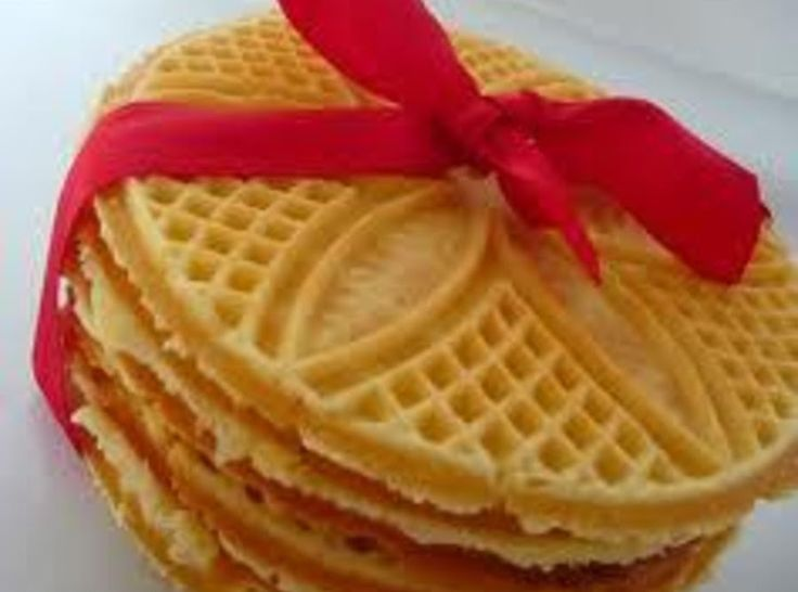 """""""Pizzelles are light wafer cookies made from a simple batter flavored with a hint of lemon or in this case, maple. The batter is cooked on a special pizzelle iron (also known as a cialde iron) which embosses the cookies with decorative patterns such as flowers and stars. In central Italy, where the pizzelle originated, families would choose their own distinctive patterns and pass them down from generation to generation. These are a tradition for Italian families in R.I. & Mass""""...."""