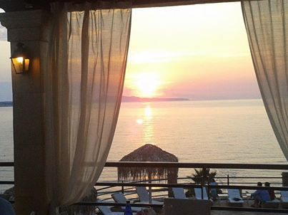 A vibrant sunset at restaurant Kohili. Delfino Blu Boutique Hotel..