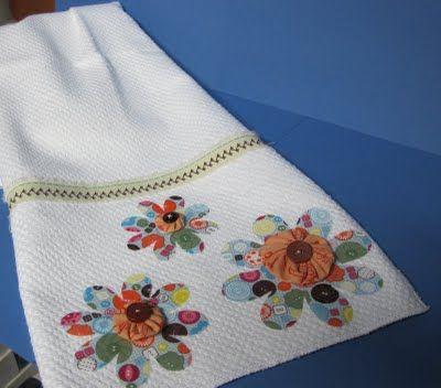 pretty yo yo flowers on a kitchen towel