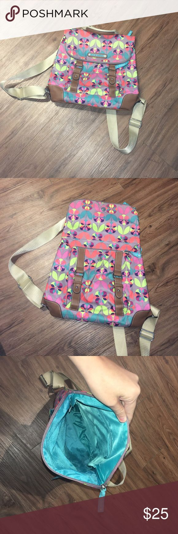 Lily Bloom Backpack Almost new Lily Bloom backpack! Used once for a vacation, but has no significant signs of wear except for small mark on strap (pictured). Contains 4 zippered compartments for storage and is PERFECT for vacationing. Lily Bloom Bags Backpacks