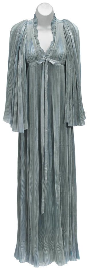 Vivien Leigh negligée from Gone With the Wind Selznick International Pictures, 1939. Ankle-length pale blue accordion-pleated silk negligée with angel sleeves, hook-and-eye closure at the bodice with blue satin ribbon detail.