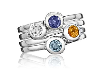 stackable birthstone rings....would be cool to have for however many kids..and my husband of course..and have all their different birthstones.