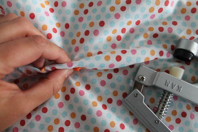 Poser une pression KAM loin du bord du tissu
