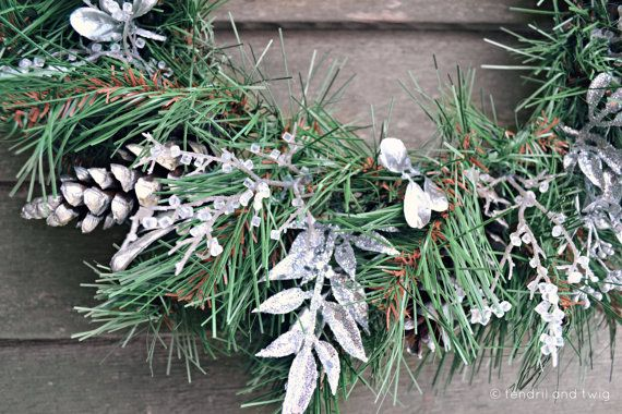 faux evergreen and silver pinecone wreath