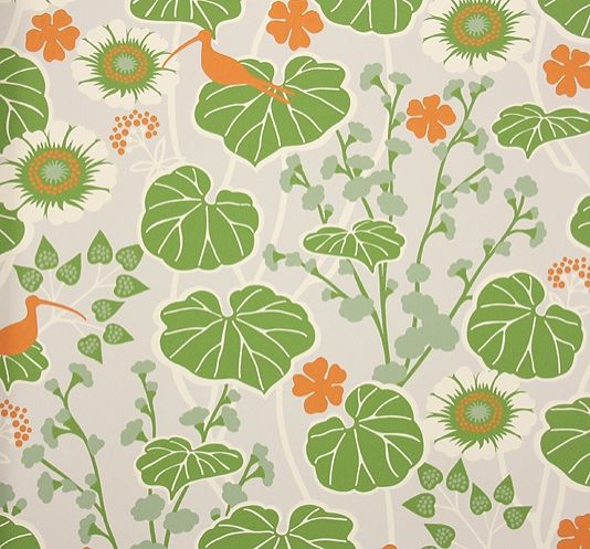 Klattervippa Wallpaper A bright bold floral with lily pads and pond flowers in greens, white and orange with a light grey background.