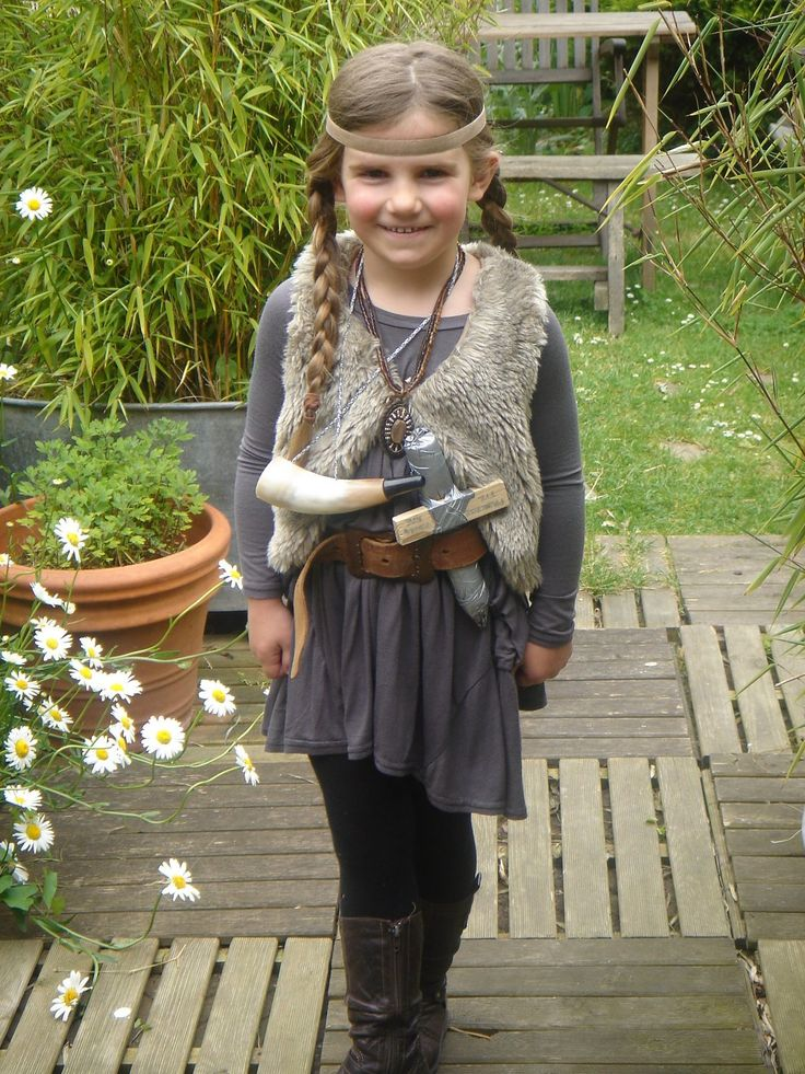 Little girl wearing Viking costume