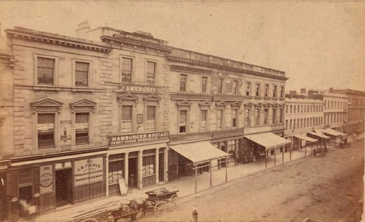 George St,Sydney,between Margaret and Barrack Streets in 1869.*John Hamburger Bros & Co....fancy goods*J.B. Tickle at 311 George St....woollen and clothing.