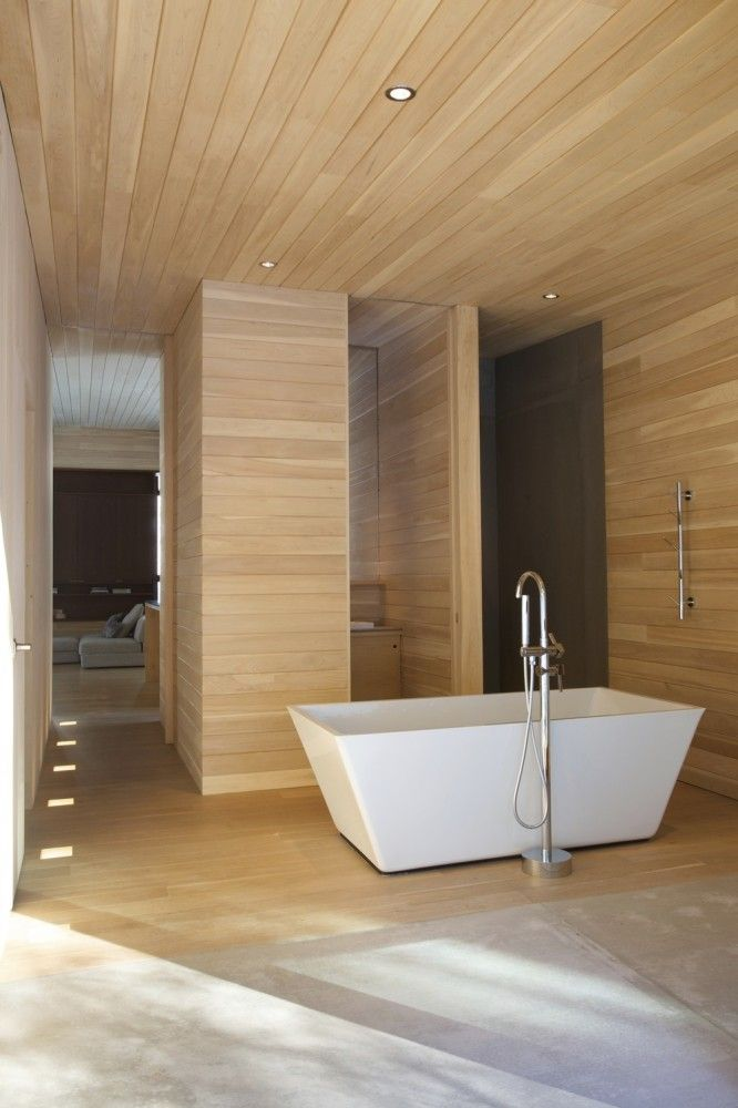 "Modern wood panel bathroom, the grains give it a ""cave"" like feel"