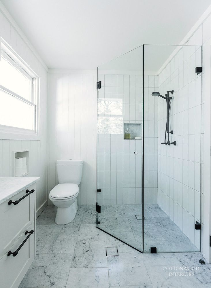 Black and white bathroom with Carrara marble - Cottonwood Interiors. Photo by Maree Homer.