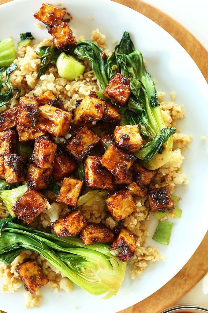 BAKED NOT FRIED crispy tofu in a 5-ingredient peanut glaze! So friggin' delicious especially over cauliflower fried rice!! #vegan #glutenfree #minimalistbaker