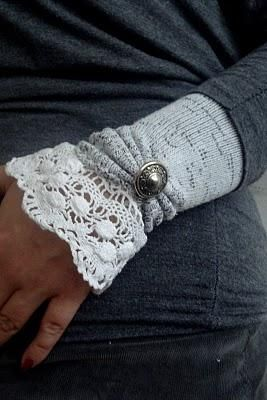 Fabulous wrist warmers from a child's sock.  Cut off at each end, gather the heel and sew on a decorative button, attach the lace to one end and hem the other end. cool!