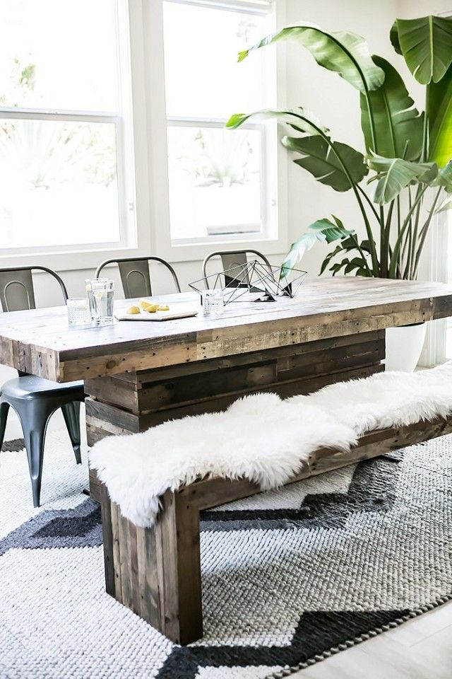 Boho dining room with a reclaimed wooden dining room table and a lamb throw