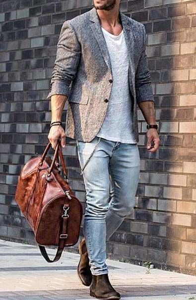 Consider pairing a grey wool blazer jacket with light blue skinny jeans to create a smart casual look. Take a classic approach with the footwear and opt for a pair of dark brown suede chelsea boots.   Shop this look on Lookastic: https://lookastic.com/men/looks/blazer-crew-neck-t-shirt-skinny-jeans/21400   — Grey Wool Blazer  — White Crew-neck T-shirt  — Light Blue Skinny Jeans  — Brown Leather Holdall  — Dark Brown Suede Chelsea Boots