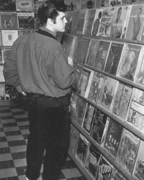 Elvis checking out new releases at a Hollywood record shop