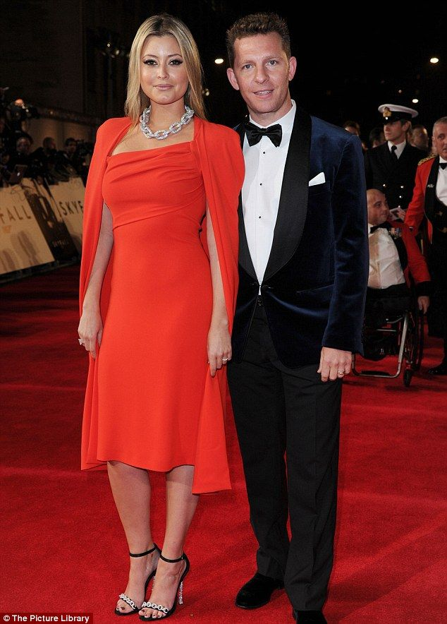 Newlywed Holly Valance wore a tight fitting scarlet frock with a cape as she joined husband Nick