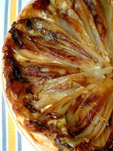 Tarte tatin aux endives. But add caramelized onions as well. #tarts #spagettinileresto