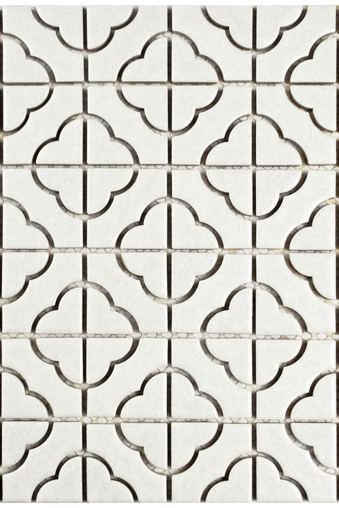 This porcelain mosaic tile features a mottled white coloring and clover shaped chips. The subtle texture and light crackle effect to the glaze adds visual interest that complements the cloverleaf design.