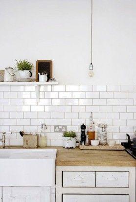 white tiles - simple light - wooden worktops
