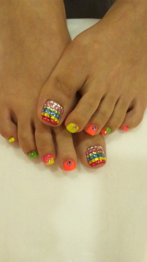 rainbow bling toe nails,but I'm not much of a stripe fan but still cute:)