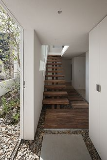 Frame house stairs by UID architects. Note center support to stairs - could be used outdoors too.