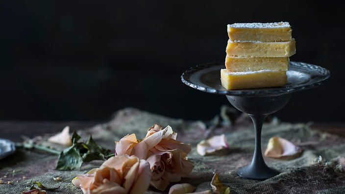 Lemon bars are one of those 'clever' slices that combines a simple shortbread-like base and an intensely-tart/sweet lemon topping to create a memorable mouth puckering moment. @annekamanning, you're onto something.