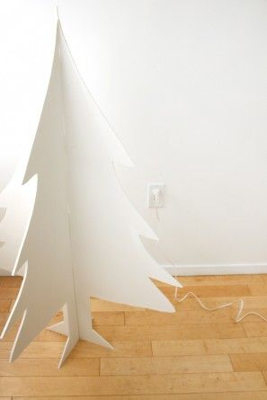 3 dimensional foam board christmas tree - pin snowflake ornaments to this for the bazaar?  Paint green?