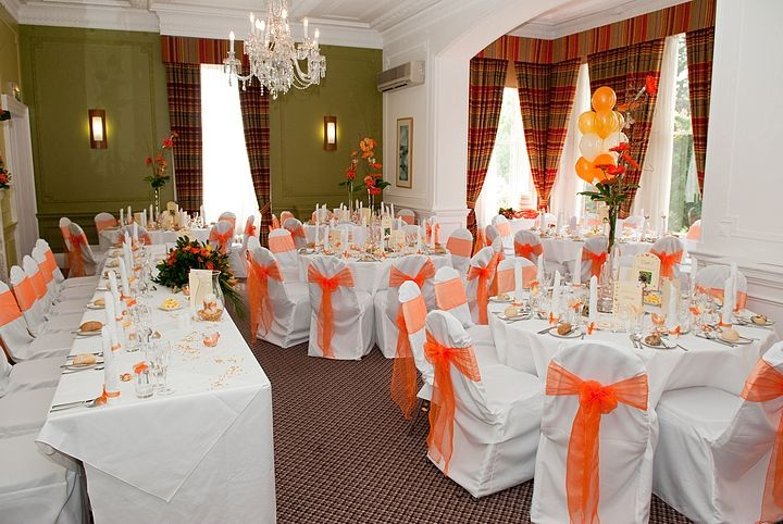 Orange Organza Bows on White Chair Covers
