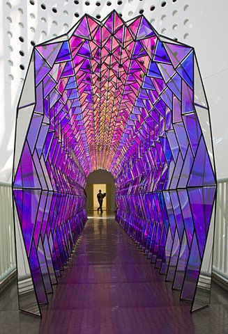 This shows an example of architecture which has been made of different colour glass. When light reflects through this, the natural light will shine different colours and create interesting effects.