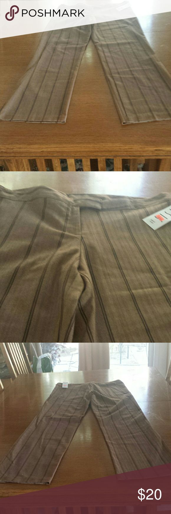 Brown slacks  M L Brown  slacks with black pinstripes  Made in USA  M waist  36 in inseam  34 in  63 %  polyester  32 % rayon 3 % spandex Is is Los Angeles  Pants Trousers