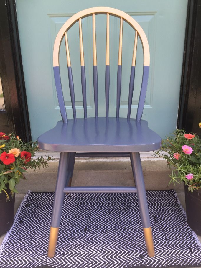 Gilded gold painted navy blue chair. A little bit gold dipped style need color blocking. Love the arched spindle back style of this chair. For mismatched dining table, desk chair or side chair in guest room or office?