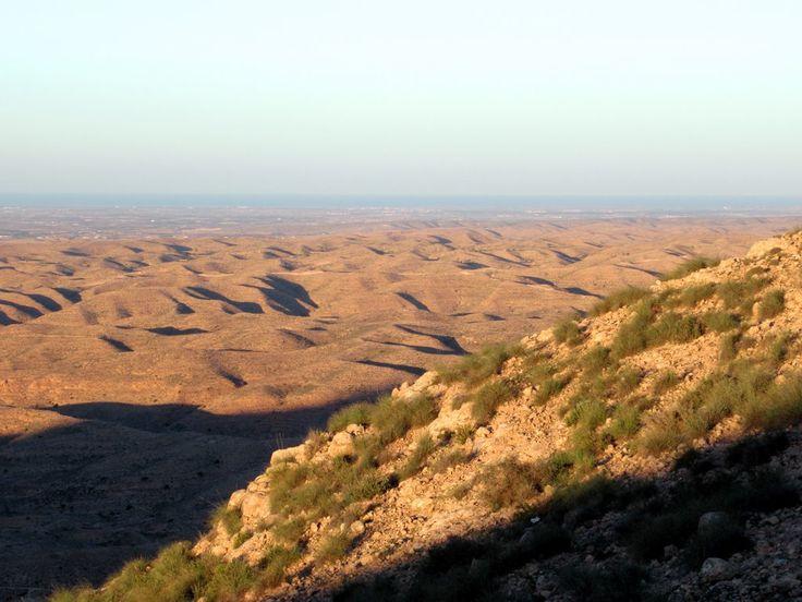 The mountain road to Toujane, Tunisia, provides views across the lunar-like landscape down to the coastal plain.