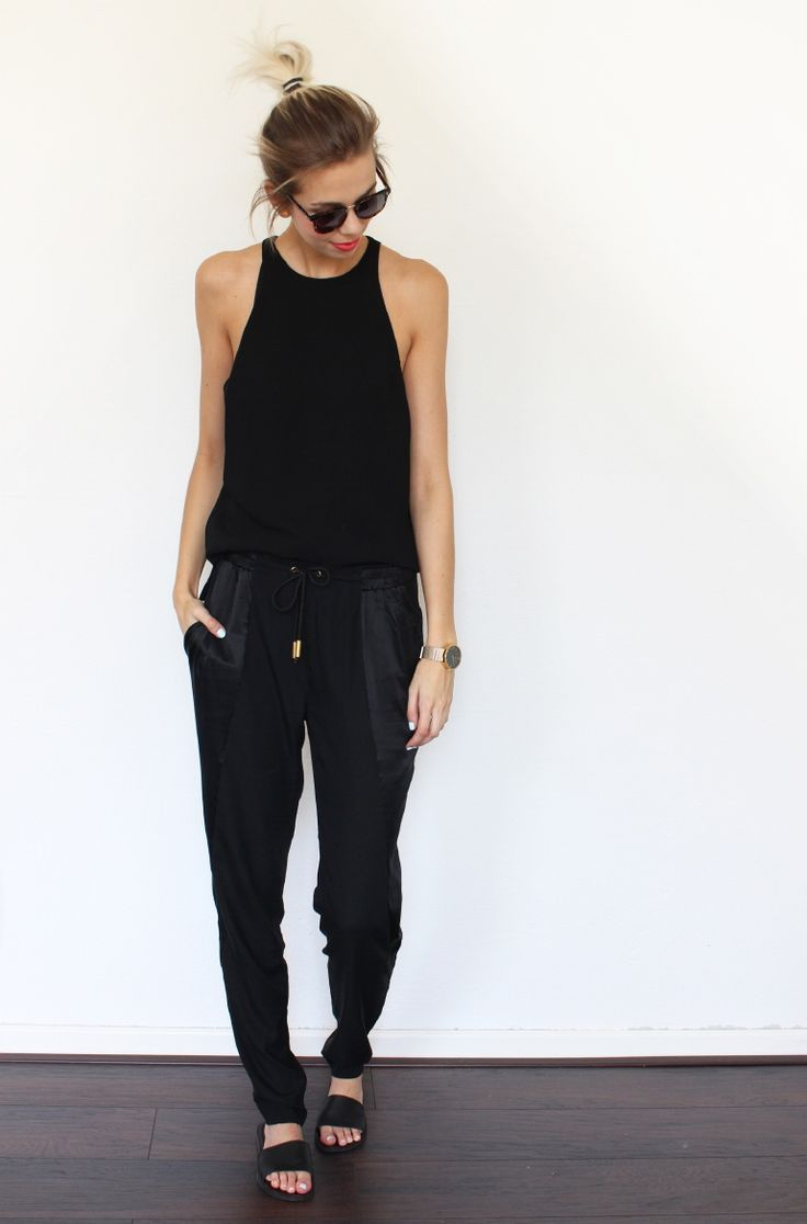 a black jumpsuit and slip on sandals.