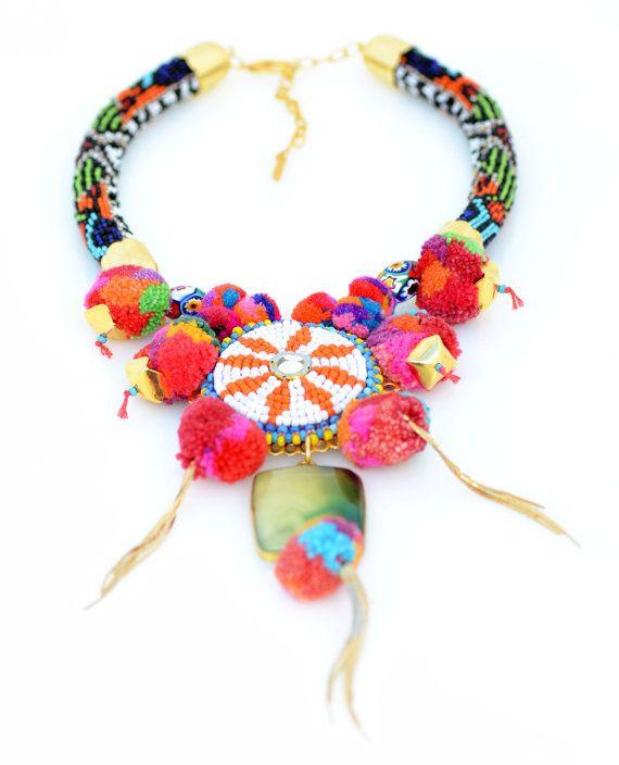 Bohemian pom pom necklace with vintage beaded patch.