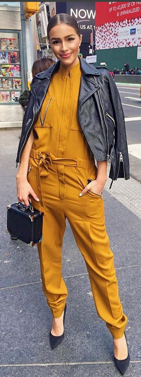 Olivia Culpo wearing Bag – Aspinal of London Jumpsuit – Victoria Beckham Collection