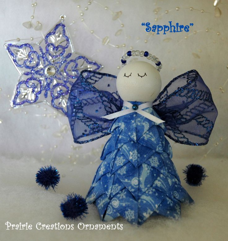 "Sapphire is a beautiful sapphire blue angel ornament.  Her body is made from a blue fabric with mettalic snowflake swirls and wings are a bright blue glitter ribbon.  Her halo is hand beaded to match.  She is sure to be a beautiful addition to your ornament collection or Christmas decor! Everything needed to make 'Sapphire' is included except the straight pins.  You will need about 250 pins.  I recommended 1"", but 1 1/16"" will work also."