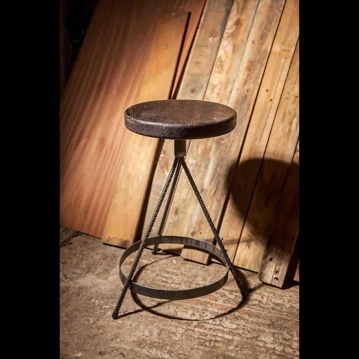 solid steel stools made from rebar and flatbar seat material is solid oak they are attached with solid brass screws
