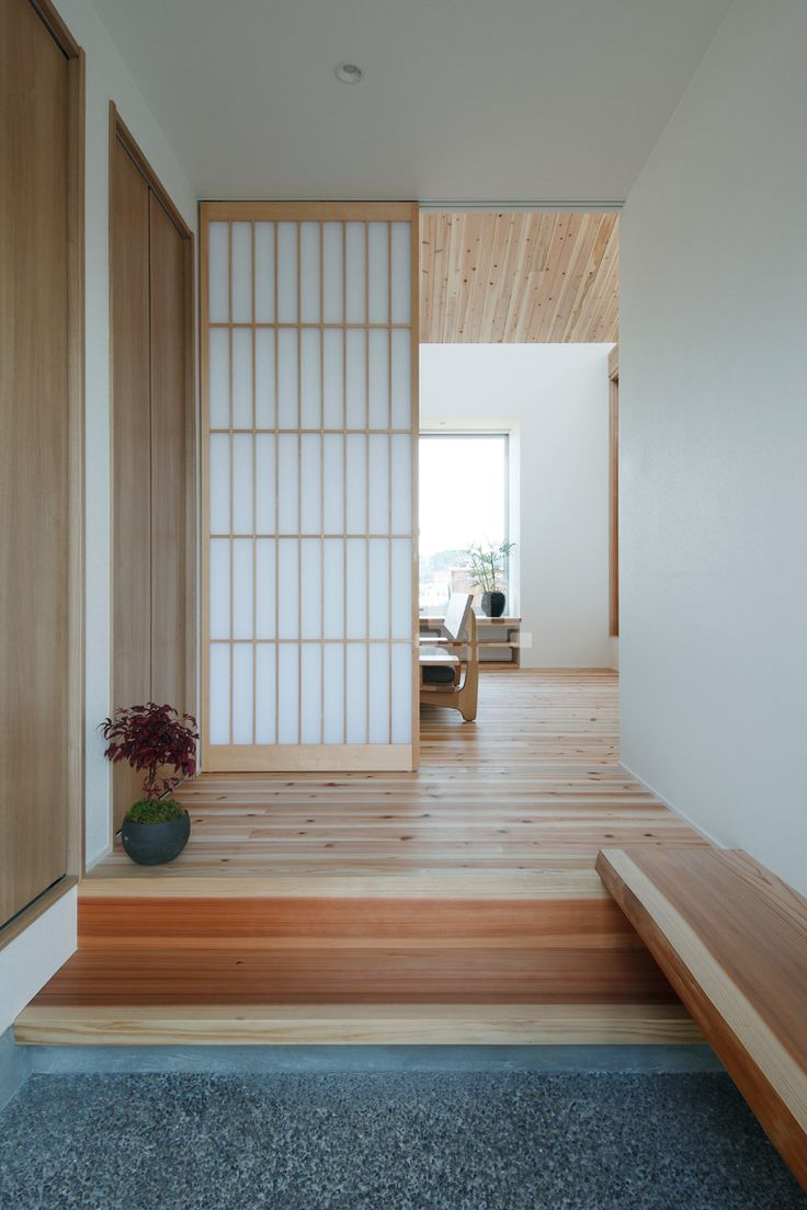 ALTS design office has designed a humble home organized a central common room situated in the rural landscape of shiga, japan.