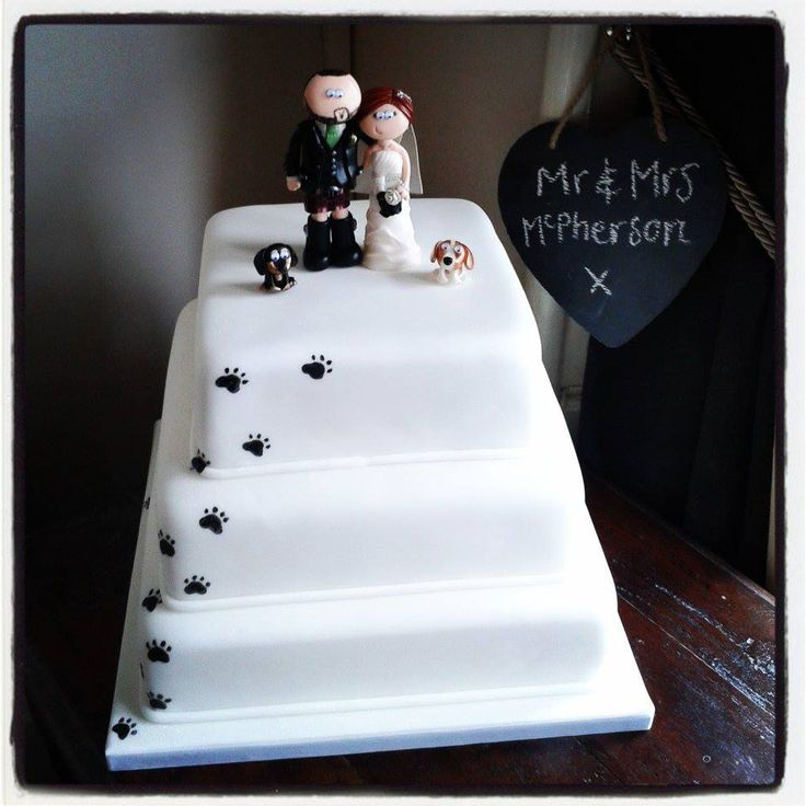 Dog paw prints on the cake, my Scottish couple with their Spaniels cake topper :o) I think this is a great combination www.googlygifts.co.uk I ship World wide!