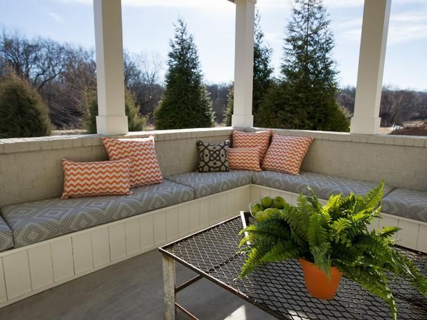 Wraparound seating dominates the corner of the porch, and a door to the basement provides easy access for entertaining indoors and outdoors.: Smart Home, Hgtv Smart, Built Ins, Built In Seats, Built In Seating, Covers Porches, Outdoor Spaces, Benches Seats, Built In Outdoor