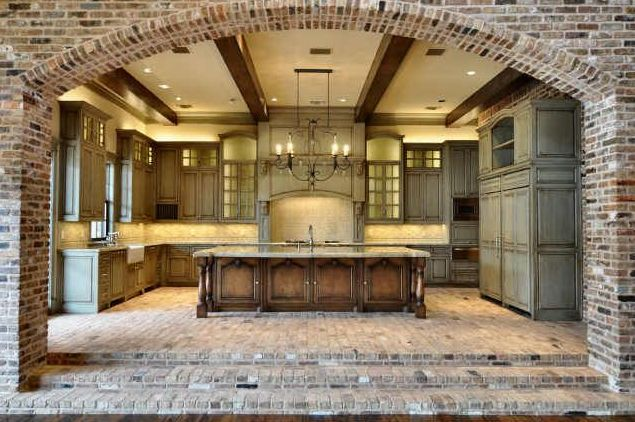 I am loving the use of exposed brick in this kitchen. My all-time favorite kitchen. Hands down.: