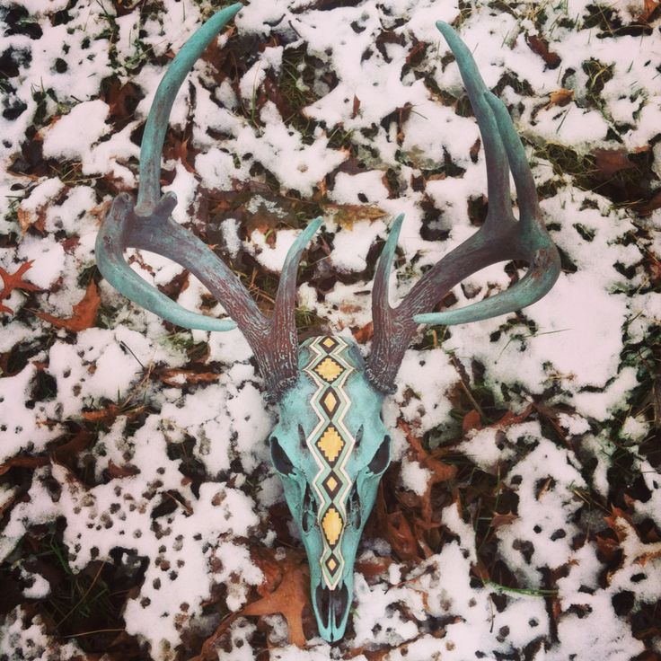 Painted deer skull european mount by Hollie Reilly with a southwest aztec design down middle of face. See it and more at facebook.com/SorrelHorseStudio