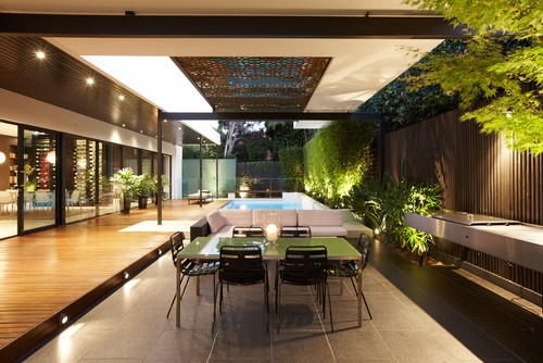 loads of cool details: lighting, decking, greenery, iron and pool, sun grid, bbq area    Houzz - Home Design, Decorating and Remodeling Ideas and Inspiration, Kitchen and Bathroom Design