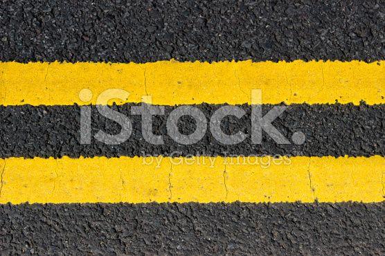 Urban texture double yellow lines on street royalty-free stock photo