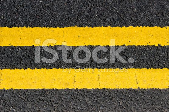 Urban texture double yellow lines on street royalty-free stock photo