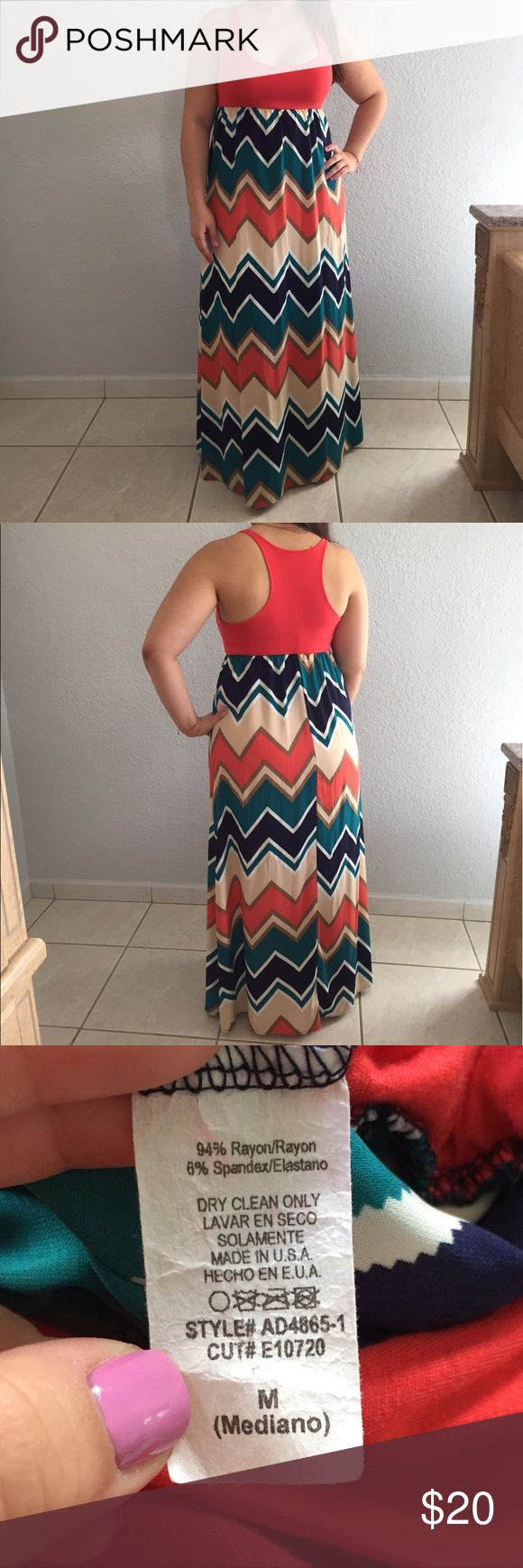 Racerback Coral Maxi Dress This maxi dress is perfect for a casual date night this summer. Pair it up with your favorite wedges. Worn only a few times. In perfect conditions. Top is very stretchy. Dresses Maxi