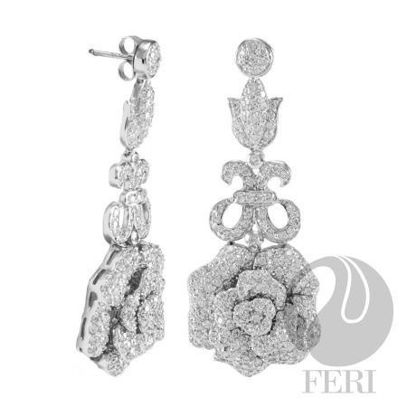"""Diana - Earrings    - 0.5 micron natural rhodium plating  - Set with thousands of AAA white cubic zirconia  - Dimension: 2.17"""" x 0.79""""  https://www.globalwealthtrade.com/vdm/display_item.php?referral=stephjames&category=66&item=5469&cntylng=&page=2"""