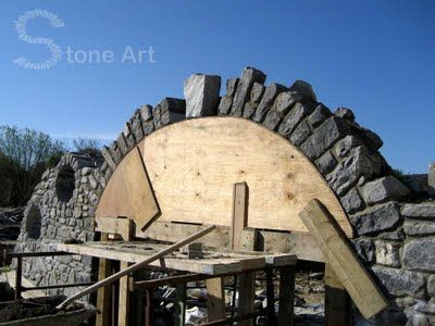 ABOVE THE GRILL AND COUNTERTOP TO LOOK INTO THE GARDENS.Building a stone archway