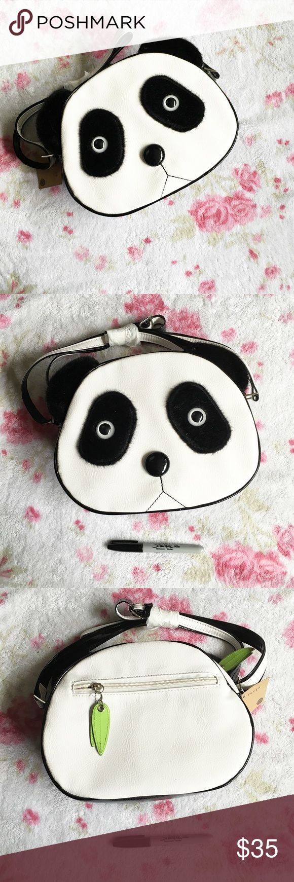 Large Panda Kawaii Crossbody Purse 🌸 An adorable, Kawaii Large Panda Face Bag !   🌸 New with tags, the strap is wrapped still   🌸 The sharpie is for scale   🌸 There are two small marks on the bag, shown in the third picture, that were there when purchased. They are not noticeable when wearing Fuego Bags Crossbody Bags