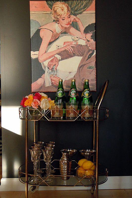 dark walls, gold bar cart